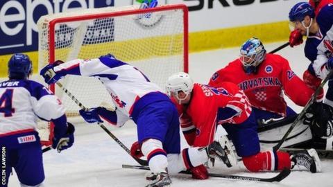 GB ice hockey team score a goal