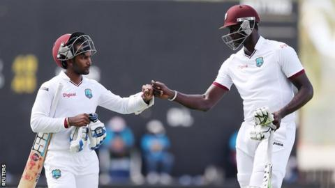 Denesh Ramdin and Jason Holder