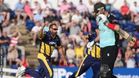 Dean Cosker celebrates after taking the wicket of Kevin Pietersen in the 2014 season