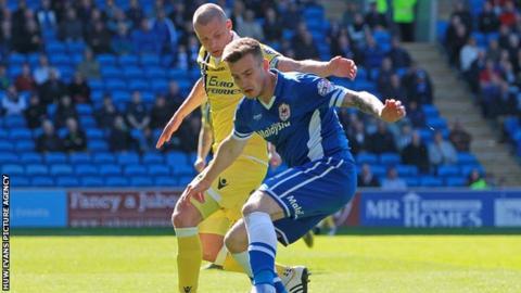 Cardiff City's Joe Ralls takes on Millwall's Alan Dunne
