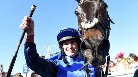 Jockey Robbie Dunne celebrates with winning horse Wayward Prince