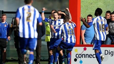 Chris Maguire celebrates Sheffield Wednesday's equaliser