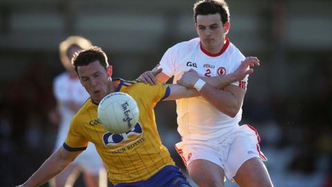 Roscommon's Diarmuid Murtagh feels the full force of Ruairi Mullan's tackle in the semi-final