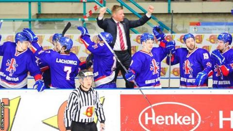 GB coach Pete Russell and his players celebrate