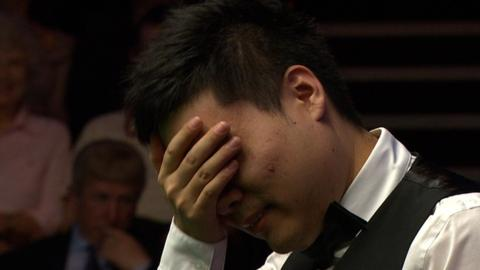 China's Ding Junhui makes a mess of a chance of 147 maximum break at the World Snooker Championships in Sheffield