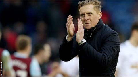 Swansea City manager Garry Monk applauds the fans