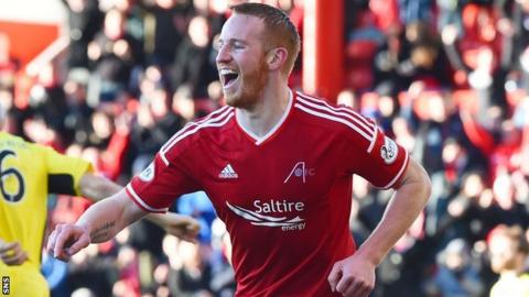 Adam Rooney joined Aberdeen from Oldham Athletic