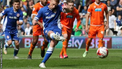 Eoin Doyle slots home his third goal for Cardiff City since signing from Chesterfield in January 2014