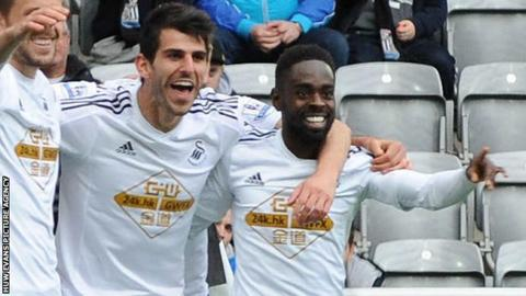 Nelson Oliveira (centre) celebrates Swansea's equaliser in the win at Newcastle - his first goal for the club