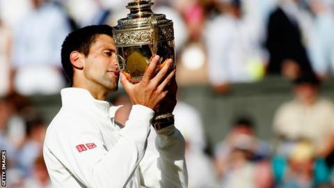 Novak Djokovic celebrates winning his 2014 Wimbledon title