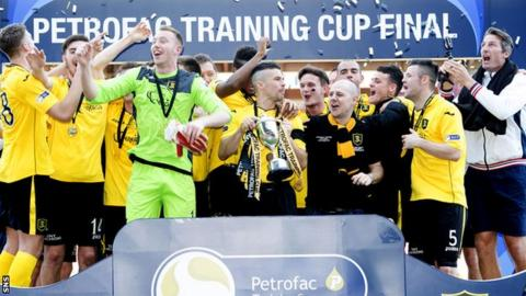 Livingston celebrate winning the Petrofac Training Cup
