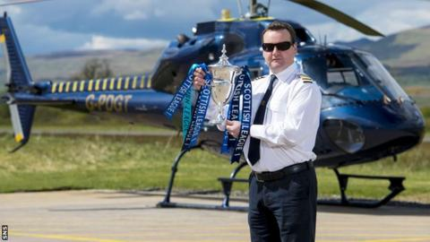 Helicopter pilot David Blane delivered the Scottish League One trophy to Morton at Cappielow
