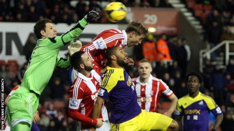 Swansea in action at Stoke in 2014