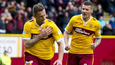 Motherwell's Scott McDonald (left) celebrates scoring his goal with Marvin Johnson