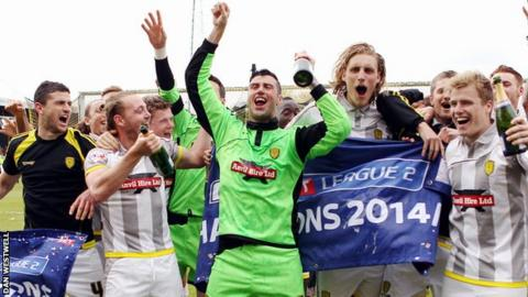 Burton Albion's players celebrate the League Two title