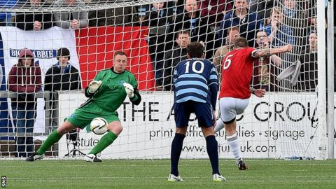 Jon-Paul McGovern scores a penalty for Ayr United against Forfar Athletic
