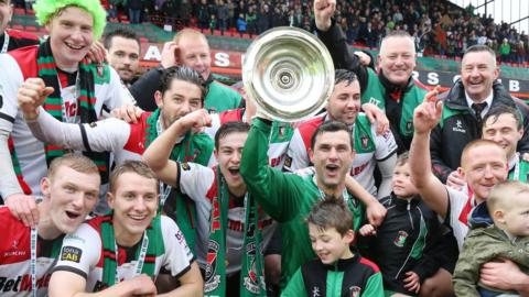 Glentoran celebrate their Irish Cup triumph - the 22nd time the east Belfast club have won the competition
