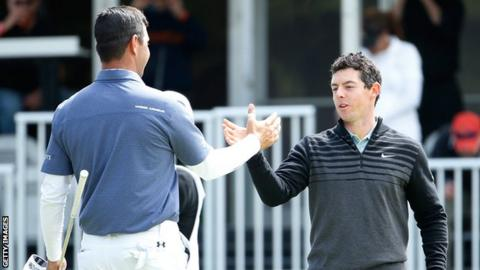 Gary Woodland and Rory McIlroy shake hands