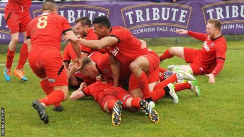 Truro City celebrate Shane White's winning penalty
