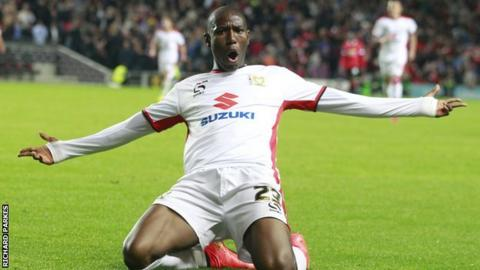Benik Afobe helped to win promotion with MK Dons