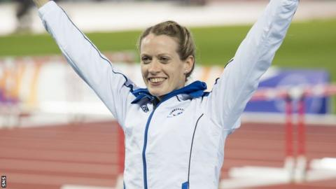 Team Scotland's Eilidh Child celebrates after winning silver in the 400m hurdles final