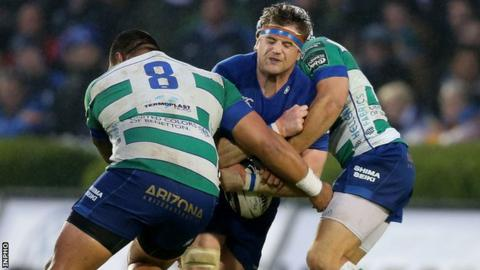 Leinster captain Jamie Heaslip is tackled by Mat Luamanu and Edoardo
