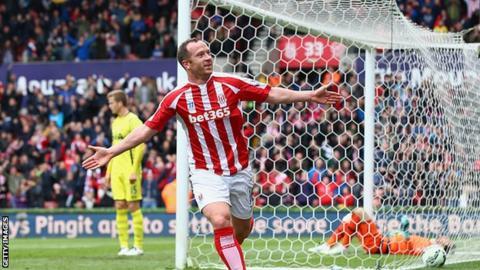 Stoke midfielder Charlie Adam celebrates scoring against Tottenham