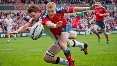 Iain Henderson makes a superb intervention to deny Keith Earls scoring an opening try for Munster