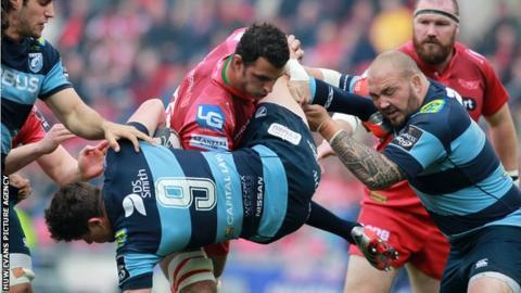 Scarlets back-row Aaron Shingler tackles Lloyd Williams of Cardiff Blues