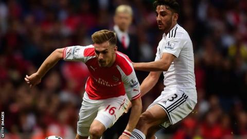 Arsenal's Aaron Ramsey takes on Wales team-mate Neil Taylor in Swansea's 1-0 win at the Emirates