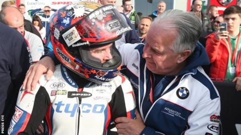 Alastair Seeley is embraced by his father after his Supersport triumph on Thursday