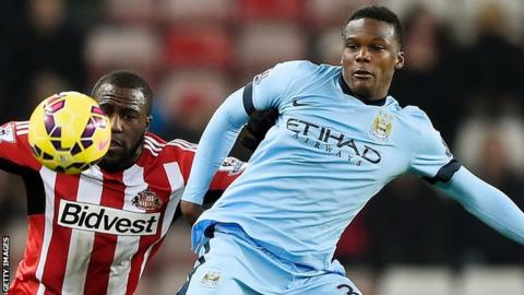 Dedryck Boyata (right) in action for Manchester City