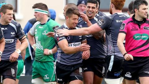 Ospreys players congratulate Rhys Webb after scoring a try against Connacht