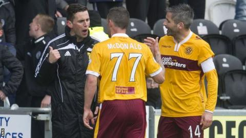 Motherwell's Scott McDonald has words with fourth official Andrew Dallas after he was sent off