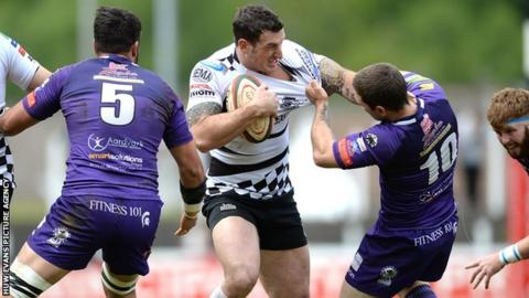 Dafydd Lockyer of Pontypridd takes on Ebbw Vale's Iain Smerdon