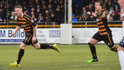 Alloa's Daryll Meggatt (left) after putting his side 3-0 up