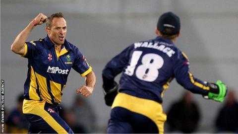 Dean Cosker celebrates taking a wicket against Surrey