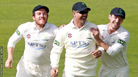Jacques Rudolph celebrates with team-mates Will Bragg and Andrew Salter