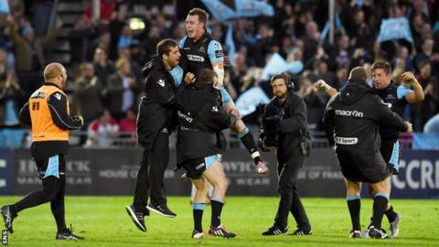 Stuart Hogg (top) celebrates with team-mates after Glasgow Warriors' win