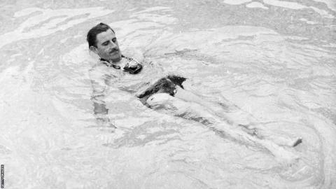 Graham Hill in the pool 1966