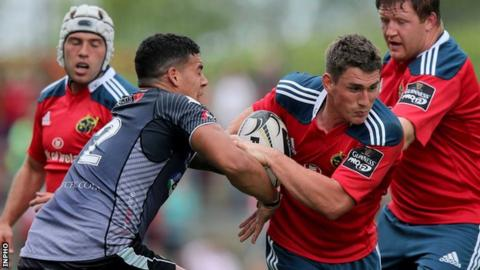 Ian Keatley attempts to get past Josh Matavesi at Thomond Park