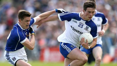 Cavan's Dara McVeety is fended off by Shane Carey of Monaghan during the Championship clash