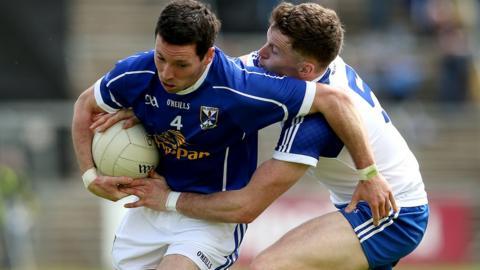 Cavan's Ronan Flanagan comes under pressure from Fintan Kelly of Monaghan