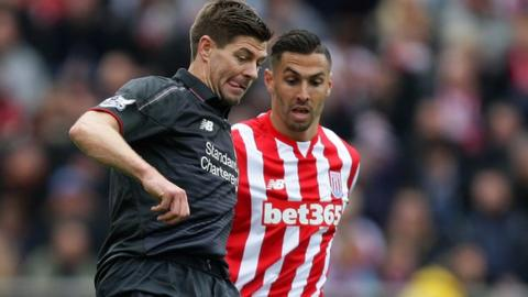 Stoke City defender Geoff Cameron challenges Steven Gerrard in the Liverpool captain's final game