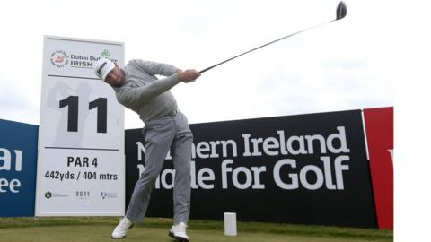 Major winner Graeme McDowell gets into the swing of things with a practice round at Royal County Down