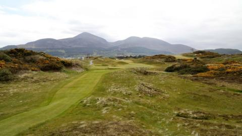 Royal County Down golf course with the Mourne mountains in the background
