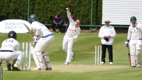 Andrew White in bowling action during the Downpatrick game