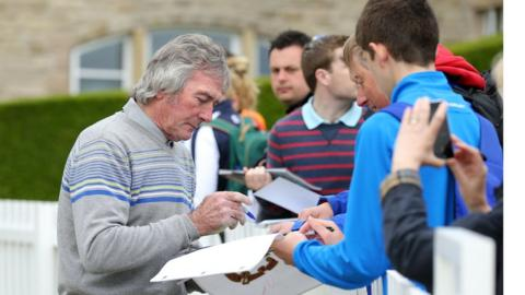 Northern Ireland goalkeeping legend Pat Jennings signs autographs for fans at Royal County Down