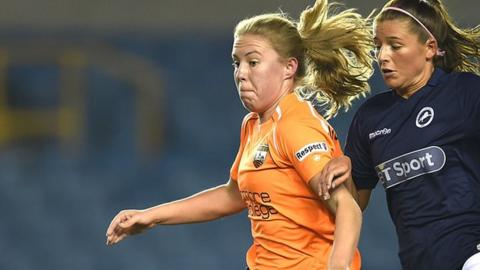 London Bee's Ashleigh Goddard beats Millwall's Ciara Sherwood to the ball