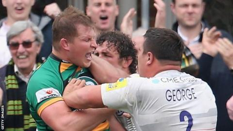 Dylan Hartley (left) clashes with Saracens' Jamie George